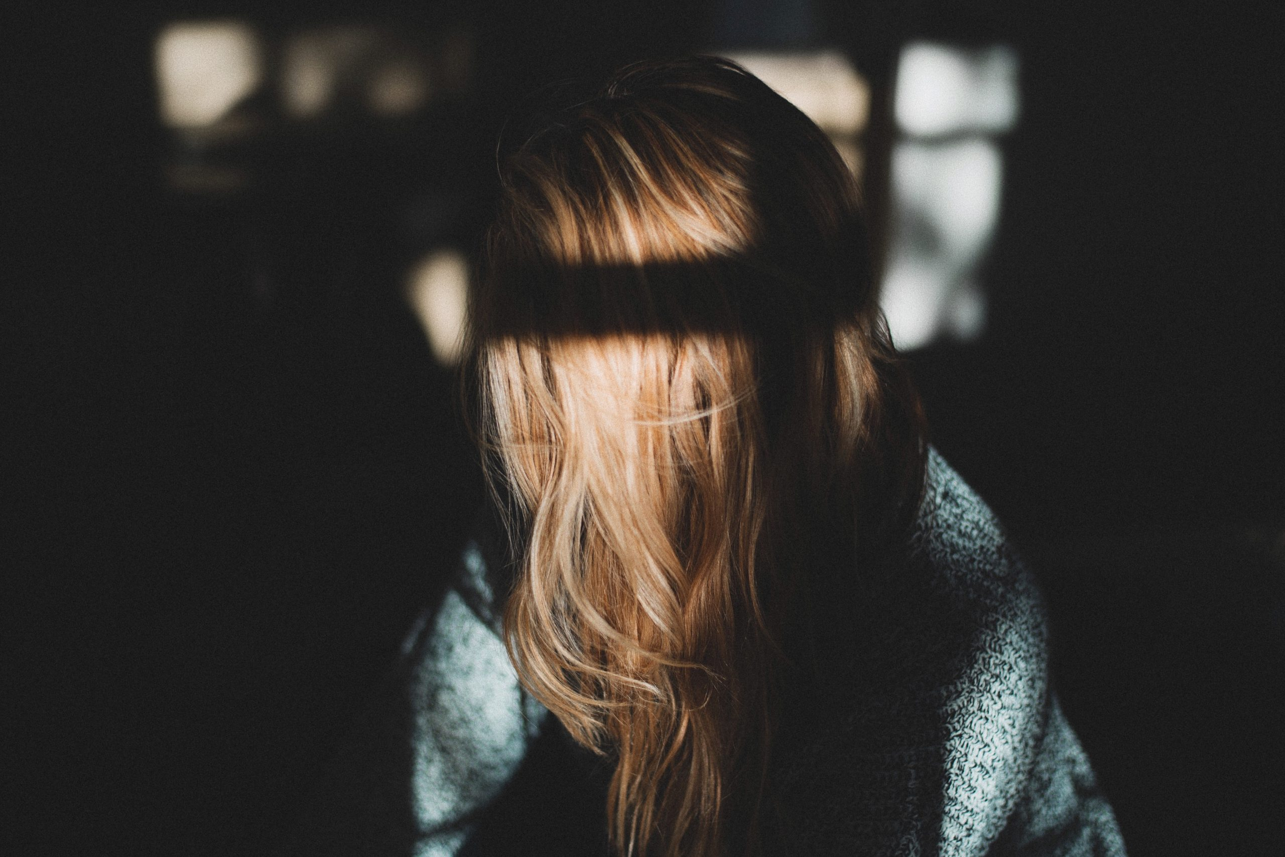 Girl with long hair covering her face